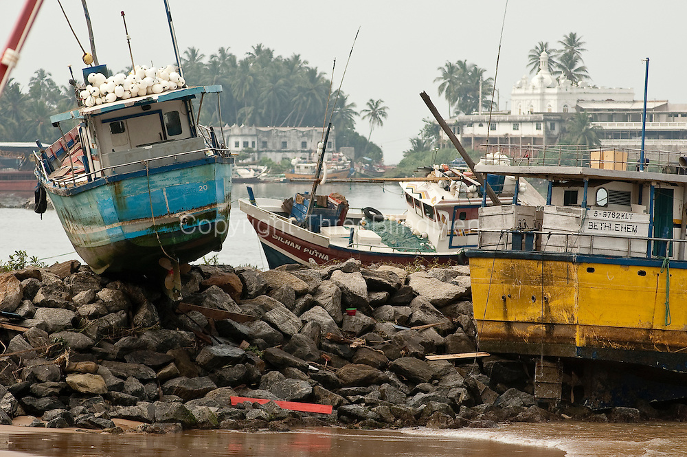 Wrecked boats on south west coast fishing harbour at Beruwela.