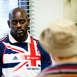 London, UK - 21 July 2012: Team GB Olympic discus thrower Abdul Buhari is interviewed by media at the Ramadan Iftar 2012 celebrations hosted at the Islamic Cultural Centre (ICC) in Regents Park.