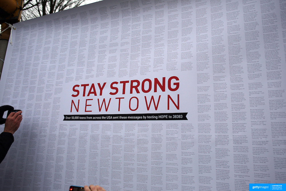 A poster bearing the messages of 50,000 teens from across america at the shrine set up around the towns Christmas tree in Sandy Hook after the mass shootings at Sandy Hook Elementary School, Newtown, Connecticut, USA. 17th December 2012. Photo Tim Clayton