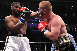 June 16, 2012; Newark, NJ, USA; Patrick Farrell (Black/Gold/Green trunks) and David Williams (White/Black trunks) trade punches during their 4 round heavyweight bout.