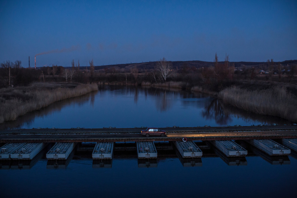 A pontoon bridge replaces a destroyed one over the Kazionnyi Torets River on Wednesday, February 17, 2016 in Slovyansk, Ukraine. The original bridge was blown up when pro-Russian rebels retreated from the town after an advance by the Ukrainian army.