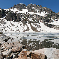 WY00615-00...WYOMING - Ice on Lake Solitude in Teton National Park.