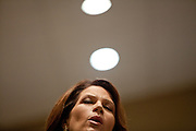Republican presidential candidate Rep. Michele Bachmann sings hymns at Living Word Outreach Ministries in Spencer, Iowa, July 31, 2011 while campaigning througout the state in advance of the Straw Poll.
