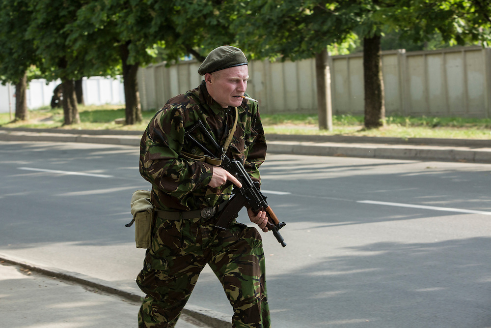 DONETSK, UKRAINE - MAY 26: A pro-Russian separatist fighter take position outside the Donetsk airport, scene of an hours-long battle between pro-Russian separatists and Ukrainian forces, on May 26, 2014 in Donetsk Ukraine. A day after businessman Petro Poroshenko won Ukraine's presidential election, separatists occupied the airport, leading to a military response. (Photo by Brendan Hoffman/Getty Images)