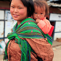 Asia, Bhutan, Wangdue. Mother and baby of Wangdu Phodrang.