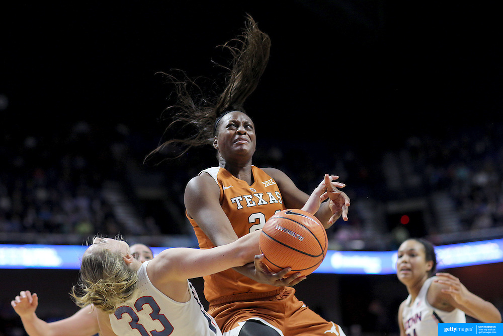 UNCASVILLE, CONNECTICUT- DECEMBER 4: Joyner Holmes #24 of the Texas Longhorns commits a charging foul as she crashes into Katie Lou Samuelson #33 of the Connecticut Huskies as she drives to the basket during the UConn Huskies Vs Texas Longhorns, NCAA Women's Basketball game in the Jimmy V Classic on December 4th, 2016 at the Mohegan Sun Arena, Uncasville, Connecticut. (Photo by Tim Clayton/Corbis via Getty Images)