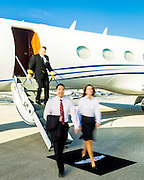 Executives exit a Gulfstream business jet at Opa-locka Executive Airport, near Miami.