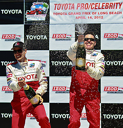 LONG BEACH, CA - APR 14: American radio personality, television host, comedian, and actorAdam Carolla celebrates with Pro drifter driver Fredric Aasbo after winning the 2012 Toyota Celebrity/PRO Race in Long Beach, CA. All fees must be ageed prior to publication,.Byline and/or web usage link must  read SILVEX.PHOTOSHELTER.COM . Photo by Eduardo E. Silva