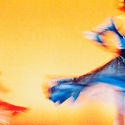 Dance, Flamenco, swirling dresses red and blue against yellow backdrop, abstract;women;twirling;vivid