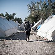 A refugee walks in the Kara Tepe camp