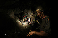 Ametista do Sul, RS, Brazil, 28/02/2008, 13h02: Searching for amethyst, a semiprecious stone, miners dig tunnels through the mountains in southern Brazil. This kind of mining is known for its  harmful dust.  The silicon dioxide particles can trespass the filter masks causing silicosis disease. Over 50% of amethyst miners had developed the silicosis, a disease that has only one cure: Lung transplant..(photo: Caio Guatelli)
