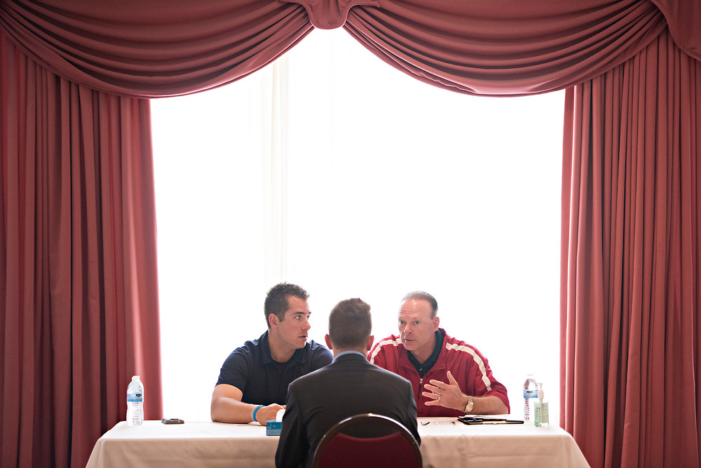 DAYTONA BEACH, FL - FEBRUARY 4, 2016:  During evaluations, Minor League Umpire John Libka, left, and Major League Umpire Ed Hickox, meet with Brandon Blome, the Top Student from the 2016 Wendelstedt Umpire School class.(Photo by Melissa Lyttle)