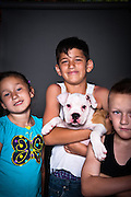 Puppy dog Karma with children Alicia, Anthony, and Adrian.