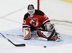 Feb 26, 2009; Newark, NJ, USA; New Jersey Devils goalie Martin Brodeur (30) makes a save during the first period of their game against the Colorado Avalanche at the Prudential Center.