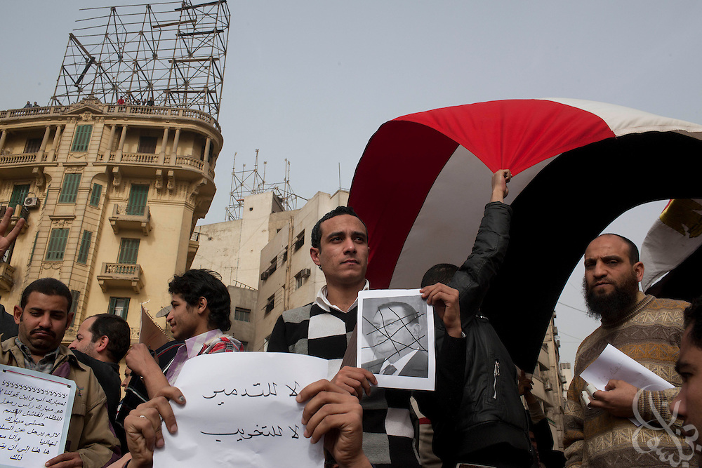 Egyptian protesters hold anti-Mubarak signs in central Tahrir square in downtown Cairo January 29, 2011. The widespread protests across Egypt are an unprecedented challenge to the rule of President Hosni Mubarak.