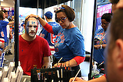 May 13, 2015 - New York, NY. Mike Guttentag gets his facepainted at Rangerstown, a fan installation for Rangers Fans, in preparation for game 7 of the Rangers-Capitals series at Madison Square Garden.  Photograph by Anthony Kane/NYCity Photo Wire