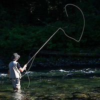 WA09155-00...WASHINGTON - Fly fishing on the Middle Fork of the Snoqualme River near North Bend. (MR# J9)