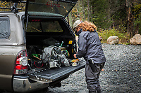 Fly fishing guide and Patgonia Ambassador, Rahcel Finn gears up behind her pickup truck before a day on the West Branch of the Ausable River, Wilmington, New York
