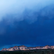 Storm clouds gather over the multi-colored Elkheart Cliffs, located near Mt. Carmel Junction, Utah.