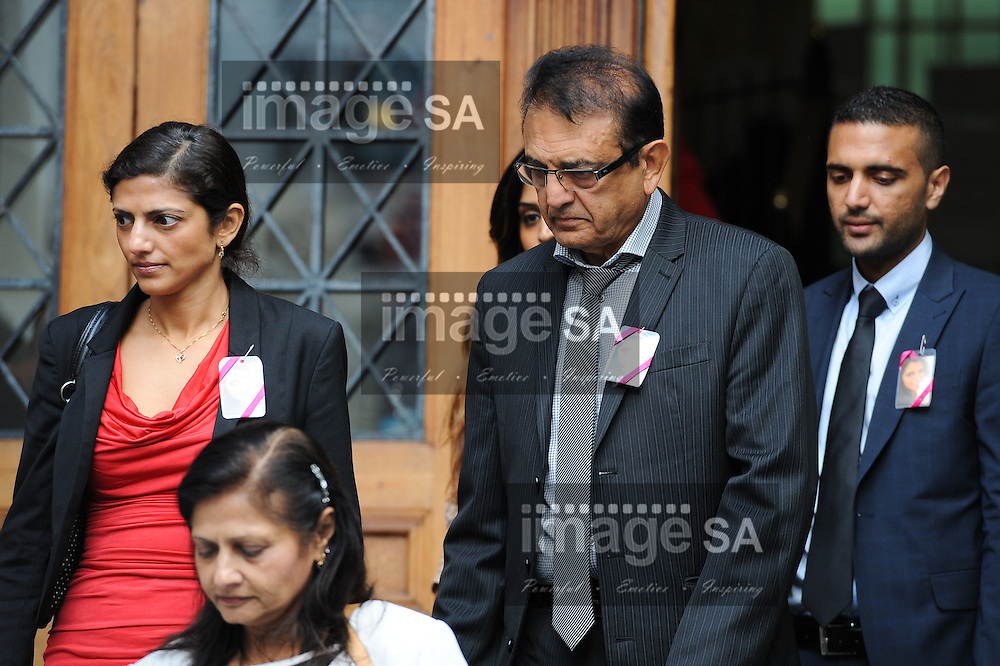 CAPE TOWN, SOUTH AFRICA - Wednesday 8 October 2014, Vinod Hindocha (right, father of Anni) leaves the court with his family after the day's proceedings during Day 2 of the Shrien Dewani trial at the Cape High Court before Judge Jeanette Traverso. Dewani is caused of hiring hit men to murder his wife, Anni. Anni Ninna Dewani (n&eacute;e Hindocha; 12 March 1982 &ndash; 13 November 2010) was a Swedish woman who, while on her honeymoon in South Africa, was kidnapped and then murdered in Gugulethu township near Cape Town on 13 November 2010 (wikipedia).<br /> Photo by Roger Sedres