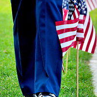September 11 Flag Ceremony at Point State Park in Pittsburgh, Pennsylvania<br /> September 11, 2001, will always be remembered as that gruesome day in American history when four airplanes were hijacked by al-Qaeda, resulting in the deaths of nearly 3,000 people. The property losses, economic impact, resulting wars and homeland security expense measured in the trillions. Those sacrifices are remembered each year in ceremonies across the nation. An example is the Flight 93 ceremony at Point State Park in Pittsburgh. A member of the Coast Guard Enlisted Association (Steel City Branch) helps to place 44 flags at the Upper Fountain Plaza in memory of those who died near Shanksville, Pennsylvania.