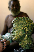 Biuku Gasa (scout that found JFK) with bust of John F. Kennedy given to him by Kennedy's Nephew Max Kennedy. Kauvi Island - Roviana Lagoon The Solomon Islands 30/06/05