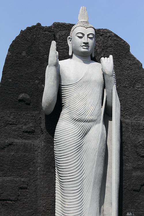 A modern standing Buddha statue, near the ruins complex at Polunnaruwa, part of Sri Lanka's Cultural Triangle
