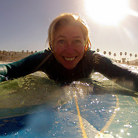 USA, California, La Jolla. Woman on surfboard at La Jolla Shores.