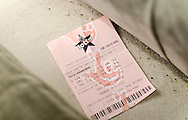 London, England - January 26, 2016: Old Lottery Ticket found down back of Sofa, The National Lottery is operated by Camelot Group since the first draw in November 1994.