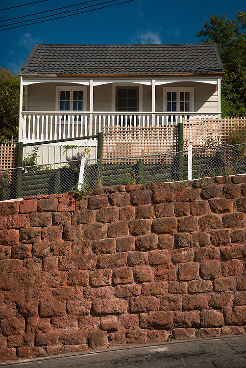 Red volcanic stone retaining wall typical of Lyttelton, NZ