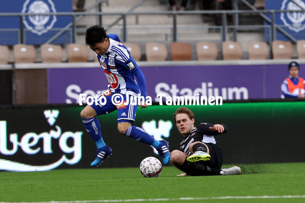 19.4.2015, Sonera stadion, Helsinki.<br /> Veikkausliiga 2015.<br /> Helsingin Jalkapalloklubi - FC Lahti..<br /> Atomu Tanaka (HJK) v Markus Joenm&auml;ki (FC Lahti).