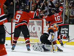 Mar 30, 2007; East Rutherford, NJ, USA; New Jersey Devils center Travis Zajac (19) celebrates after scoring during the second period at Continental Airlines Arena in East Rutherford, NJ.