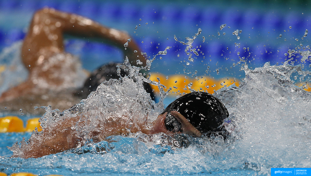 Michael Phelps USA, and Ryan Loche, USA, (front) competing against each other in the Men's 200m Individual Medley semi final at the Aquatic Centre at Olympic Park, Stratford during the London 2012 Olympic games. London, UK. 1st August 2012. Photo Tim Clayton