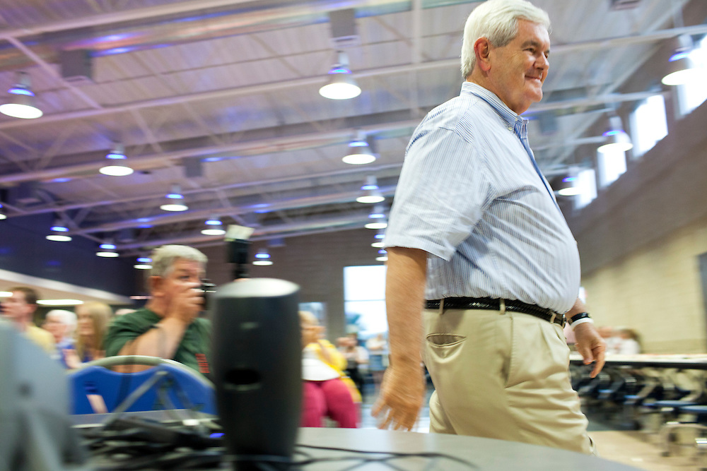 Republican presidential hopeful Newt Gingrich walks to the podium to speak at a fundraiser for the Linn County Republican Party on Friday, August 5, 2011 in Tiffen, IA.