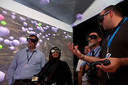 Daniel Acevedo Feliz (r), a visualization scientist with King Abdullah University of Science and Technology (KAUST) gives invited members of the press a hands on demonstration of the advanced visualization center during a tour of the soon to be inaugurated campus September 22, 2009 (about 80 kilometers north of Jeddah.) Cornea is a fully immersive, six-sided virtual reality facility that gives students and researchers the ability to turn data into 3D structures that they can interact with and examine. It was built in partnership with the University of California, San Diego.  Photo by Scott Nelson