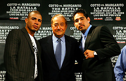 May 22, 2008; New York, NY, USA;  WBA Welterweight Champion Miguel Cotto (l) and Antonio Margarito (r) pose around promoter Bob Arum during the press conference announcing their  fight.  The two will meet on Saturday, July 26, 2008 at the MGM Grand Garden Arena in Las Vegas, NV.
