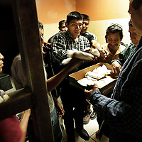 A group of Guatemalan immigrants are handed burritos while in a Mexican prison awaiting deportation back to Guatemala in Agua Prieta, Mexico caught by U.S. Border Patrol agents and handed to Mexican police.  Since  the introduction of Operation Gatekeeper and the events of 9/11, security along the border has tightened along border cities such as San Diego, El Paso and other large cities causing migrants to cross from Mexico into the United States in more remote areas.  As a result, an ever increasing number of deaths have been reported and commerce has been severely affected.  2006 was also the year hundreds of thousand Latinos took to the streets across the United States in an effort to show Congress and the President how vital they are to America.
