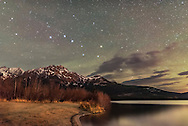 The Big Dipper over Pyramid Mountain and Pyramid Lake in Jasper National Park, Alberta, October 19, 2016, on a dark moonless night before moonrise. Some foreground illumination comes from lights across the lake on the Pyramid Lake Lodge. The sky has some green from airglow or diffuse aurora. Haze and thin clouds add the natural glows around the stars. No filter was used here.<br /> <br /> This is from a latitude of 54&deg; N so the Big Dipper does not set and is circumpolar despite it being at its lowest point in the sky for the year in the northern autumn season. <br /> <br /> This is a stack of 8 x 20-second exposures for the ground, mean combined to reduce noise, and one 20-second exposure for the sky, all at ISO 6400 with the Sigma 20mm lens at f/2 and Nikon D750. This was from 350 frames shot for a time-lapse sequence.