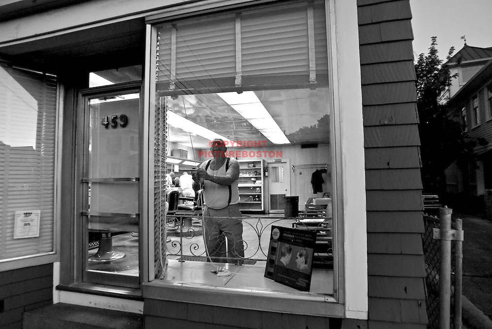 """Dick & Sons"" barber shop, a north shore landmark, will be closing after 72 years in business.  Dick Maniglia, an immigrant from Sicily, started the business in 1935. His sons Tony, Richie, Joey and Uncle Al Maniglia all worked here with dad. Dick, Al and Joey have since passed away, leaving only Tony and Richie.  .       Here, with only days left before the closing, Tony shuts the shades like he has been doing for over a half century."