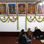 People sit in the tempe prayer room during a Holi festival at the Sanatan Dharma Hindu Temple and Cultural Center in Maple Valley on Saturday, March 10, 2012. Holi, the Festival of Colors, is a Hindu festival welcoming spring. It is most well-known for the vibrant bursts of gulal, the powdered dye, that festivalgoers throw on each other. (Joshua Trujillo, seattlepi.com)