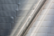 Detail the curved and folded exterior of stainless steel panels of Walt Disney Concert Hall, Los Angeles