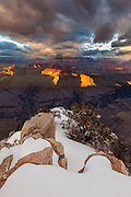 A winter sunset from the snowy South Rim of Grand Canyon National Park.