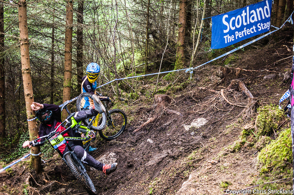 Nevis Range, Fort William, Scotland, UK. 4th June 2016. Calub Burgess of New Zealand takes a tumble as the roots get the better of his technique going through the woods. The worlds leading mountain bikers descend on Fort William for the UCI World Cup on Nevis Range.