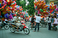 Despite the traffic, the Old Quarter of Hanoi retains its original street layout and architecture. At the beginning of the 20th century the entire city consisted of only about 36 streets, most of which are now the old quarter. Each street had merchants and artisans specialized in a particular trade such as silk, jewellery, coffee and herbalists. Its small streets are still very much alive with color and local life.