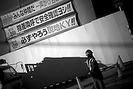 Commuters make their way through the exits of the Hankyu line of the JR rail station in Osaka, Japan January 18, 2009. Though, remaining the second largest economy in the world, Japan's parliament is in the final stages of enacting a US$54-billion extra budget to fight recession as the ruling coalition and opposition clashed over cash handouts.