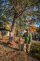 """Simply Landscapes owner Tony Dang with his six year old son, Noah, at a work site on School Street in Calistoga, California.  """"I've been working as a landscaper since I was ten years old...my son is off school this week, so I thought I would bring him along.""""  generallandscapes@gmail.com"""