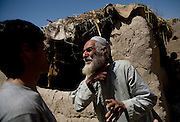 A captured Taliban gestures to a US Army interpreter during questioning near Sangin, Helmand province, Afghanistan on Wednesday, April 11. 2007.