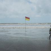 A man walk along Cox's Bazar's beach, Bangladesh