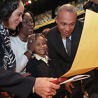 (Boston, MA - 1/15/13) Boston School Superintendent Carol Johnson, first-grade teacher Darlene White-Dottin, and Gov. Deval Patrick talk with first-grader Adriana Richardson, 7, about her writings and drawing about her dreams to become a teacher to help kids to read during an assembly at Orchard Gardens School, Tuesday, January 15, 2013. Staff photo by Angela Rowlings.