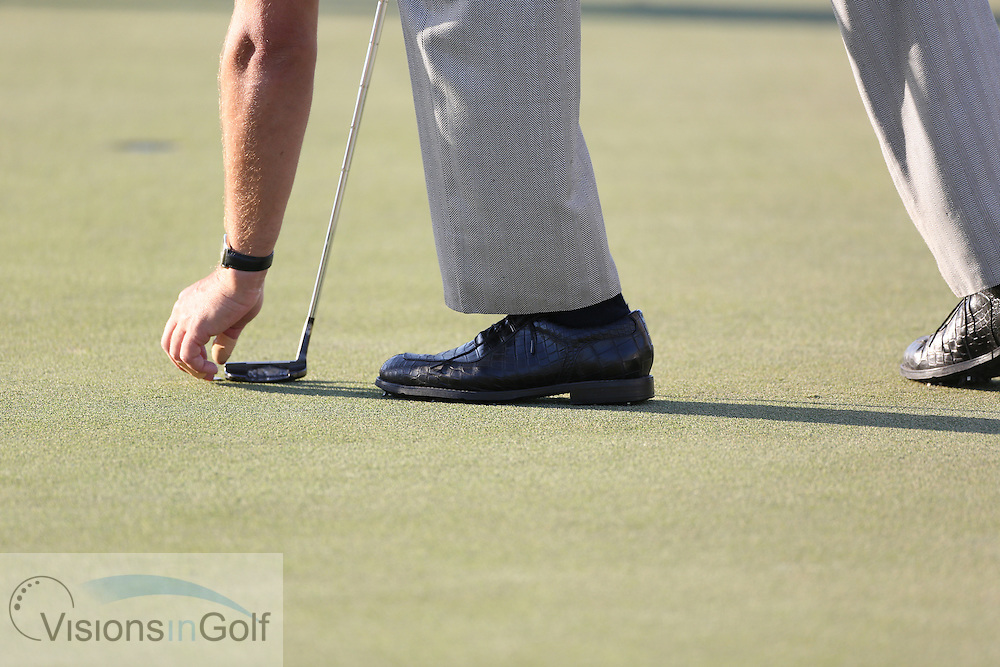 Phil Mickelson re marks his ball one putter length <br /> at the Cadillac WGC Doral, Miami, USA<br /> March 2013<br /> Picture Credit:  Mark Newcombe / www.visionsingolf.com